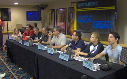 """One of the things that I'm really good at is getting a bunch of rabid Star Trek fans together in one room and starting an argument,"" says Watts.  Here, as part of Star Trek's 40th anniversary in 2006, eight fans debate which of the five (or is it six?) television series was the best Star Trek in a discussion panel called ""Star Trek vs. Star Trek."""